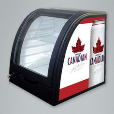 The Launcher is a thermoelectric counter top cooler with a unique curved design. This promoional cooler is ideal for product launches. Merchandising Displays, Coolers, Glass Door, Countertops, Product Launch, Design, Counter Tops, Air Conditioners, Countertop