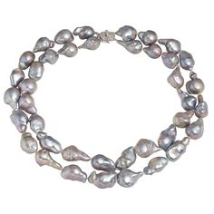 Double strand baroque pearls with diamond lock. Available at www.yanina-co.com, 800-780-3433.
