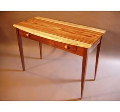 Desks: Arrival in Zebrawood and Walnut