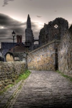 Church Lane leading to Whitby Abbey. The Abbey and town gave inspiration to Bram Stoker in writing his book Dracula.