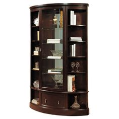 Organize leather-bound books, heirloom curios, and travel souvenirs in this elegant wood bookcase, featuring 12 adjustable shelves, 1 drawer, and 1 display l...