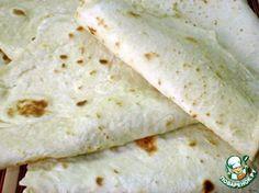 Почти как лаваш или тортилас -       Кефир— 1 стак.     Масло растительное(без запаха) — 1 ст. л.     Сода пищевая— 1 ч. л.     Соль— 1 ч. л.     Мука в\с— 2,5 стак.