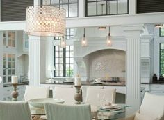 The Living Room in Grayson Mansion, as Seen on Revenge. Hamptons. They did it right on set, chandelier is $3K.