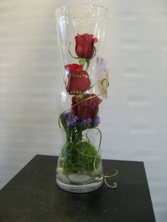 Inside arrangement with roses, green dianthus and mauve statice