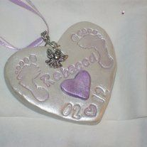This is a custom clay ornament. All come in white with colored heart, feet and writing. You must contact me with the name, date(s) and color for your ornament. One name per ornament.  Colors Available: Pink Green Gold Blue Purple No Color  You may request and alternate charm other than ...