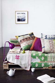 Palette sofa with kanthas  Similar kantha bedspreads from Decorator's Notebook www.decoratorsnotebook.co.uk