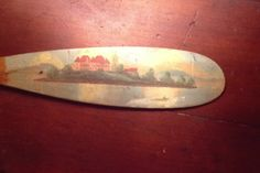 Alpheaus (Al) Keech folk artist painted signature mini canoe paddles of areas around the 1000 Island area of NY, they are highly prized by collectors, Christibys