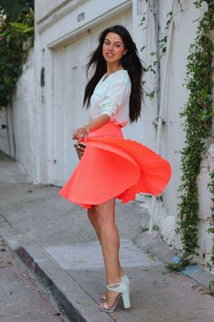 Cute style and fabulous eye catching coral colour. Perfect colour combo with the white blouse.