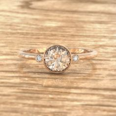 CERTIFIED 5.7mm natural champagne peach sapphire by AllSapphires. Love the bezel set and rounded soft band