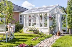 white-greenhouse-shed-with-a-stone-path This one looks good. But we should look carefully on Thursda Greenhouse Supplies, Build A Greenhouse, Greenhouse Wedding, Greenhouse Ideas, Greenhouse Gardening, Stone Path, She Sheds, Potting Sheds, Garden Buildings