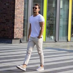 Shop this look on Lookastic: https://lookastic.com/men/looks/white-crew-neck-t-shirt-beige-chinos-beige-plimsolls/20344 — White Crew-neck T-shirt — Beige Chinos — Beige Plimsolls