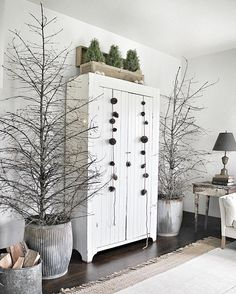 Christmas or winter decor with bare trees and white decor
