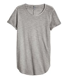 Long T-shirt in cotton jersey with sewn-in turn-ups on the sleeves, a raw-edge neckline, and rounded hem with overlocked edges.