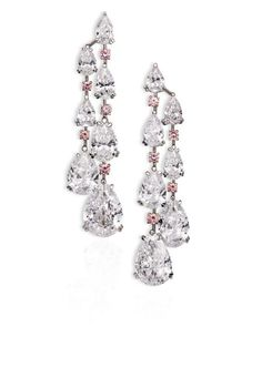 David Morris. Important white diamond chandelier earrings comprising D/IF pear shapes with vivid pink diamonds. Total weight 49.10cts.