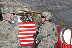 """""""I decided to re-enlist today because the Army is a great place for me. Throughout the past 12 years, I have given my life to the Army and the Army has paid me back in many ways."""" –Sgt. 1st Class Jeremy K. Schwanke   Caption: (Left to right) Capt. Christopher McWhirter administers the re-enlistment oath to Sgt. 1st Class Jeremy K. Schwanke, a native of Newport News, Va., onboard a CH-47 Chinook helicopter. (DVIDS photo by Sgt. John Ortiz. Used with permission.)"""