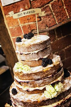 Naked Cake with blackberries, made by the bride's mum - http://whimsicalwonderlandweddings.com/2014/01/quirky-pub-winter-wedding.html