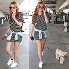 Bella Thorne and her pet dog departing from Los Angeles International Airport (LAX) in Los Angeles, California, on September 11, 2015