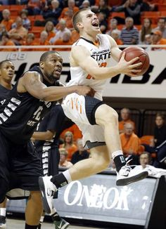 Oklahoma State's Phil Forte (10) is folded by Portland State's Lamont Prosser (42) during the college basketball game between Oklahoma State University and Portland State, Sunday,Nov. 25, 2012. Photo by Sarah Phipps, The Oklahoman