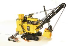Combining LEGO Technic and System bricks into a cohesive model can be challenging, but Arjan Oude Kotte is a master LEGO engineer. Arjen brings us this incredibly detailed model of the Caterpillar 7495 Electric Rope Shovel built to minifigure scale. This model of the titanic heavy equipment machine towers over the minifigures and pickup truck …