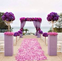 Purple themed wedding on the beach..Love those purple flowers! need to find what they are