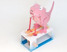 Turn the handle on the Ski Rex and watch our prehistoric friend indulge in a bit of cross country skiing! This model is actually a mash-up of the double crank box model and the pose-able T. Rex wit…