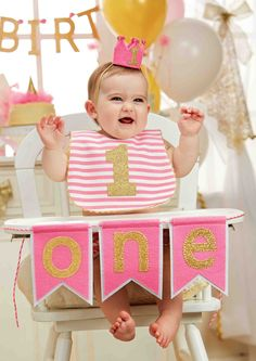 Decorate baby's high chair for her big first birthday with this unique first birthday celebration banner, featuring glittered felt 'one' pennants attached to twisted cord. A perfect high chair accessory for the big day!