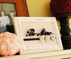 """""""Be Mine"""" Scrapbook page.  Lightly trace (or print) the words """"Be Mine"""" onto scrapbook paper.  Take black cardstock and cut into 1/2"""" strips.  Bend and curve strips along outline of letters.  Run a thin bead of hot glue along outling of letters.  Press cardstock letters into place."""
