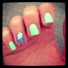 tropical theme with her seafoam nails and palm-tree nail foil.