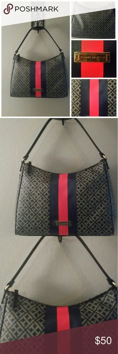 NEW!!! TOMMY HILFIGER SIGNATURE HOBO HANDBAG TOMMY HILFIGER SIGNATURE HOBO HANDBAG , COLOR BLACK/CREAM/BLUE/RED, WIDTH 13 INCHES, HEIGHT 9 INCHES, STRAP DROP 8 INCHES, TOMMY HILFIGER STRIPES DOWN THE FRONT ONLY, GOES WITH ANY WARDROBE CASUAL OR BUSINESS Tommy Hilfiger Bags Hobos