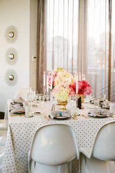 polka dot tablecloth + gold vases + pink flowers