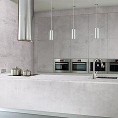 Cocina minimalista de cemento alisado