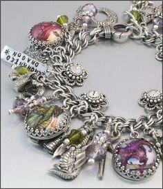 Dragon Charm Bracelet, Silver Charm Bracelet, Dragon Jewelry, The Enchanted Dragon. $97.00, via Etsy.