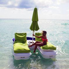i think i need this...a floating lawn chair with a umbrella and cup holder!@Emmie Deininger