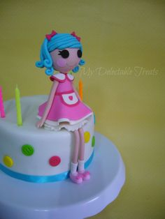 Lalaloopsy Rosy Bumps Birthday cake - My take of the Lalaloopsy Rosy Bumps Character. The figure was inspired by Delicias Com Amor e Carinho who makes the most adorable cake and table settings for this theme. You can find more of her work here on this link ...http://en.paperblog.com/lalaloopsy-rosy-bumps-themed-party-by-delicias-com-amor-e-carinho-356238/