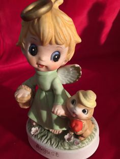 Very popular is this little Big Eyed Angel girl with her pet; she is very sweet and innocent with her crooked halo, basket of goodies and her little pet. Great for a cake topper and start of a birthday collection. Just a very cute little angel.