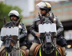 Police horses wear riot shields as demonstrators march by on the way to Baltimore City Detention Center the day of the announcement of charges against the police officers involved in Freddie Gray's arrest, Friday, May 1, 2015, in Baltimore.  -  © AP Photo/David Goldman