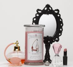 Our Bombshell Jewelry Candle is our rendition of the famous VS fragrance! This scent is a lovely, fresh citrus that adds a sparkle to a blooming bouquet of white, summer flowers. Red berry, leafy green tones and cashmere woods lead to the base of creamed musk and golden amber.      Each Jewelry Candle comes with a hidden jewel within it that has a value from $10 to $7500!