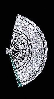 Diamond And Emerald Fan Brooch Designed As A Single And Baguette-Cut Diamond Openwork Fan With A Tapered Baguette-Cut Emerald Border To The Triangular-Cut Diamond Handle c.1930 - Christie's
