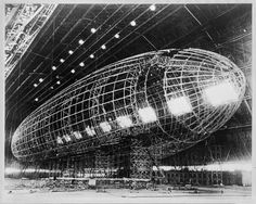 World's largest Zeppelin near completion. The metal skeleton of the Akron being constructed for the Navy at the Goodyear Zeppelin factory in hangar at Akron, 193_.