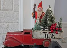 Santa & bottle-brush trees in an old toy truck