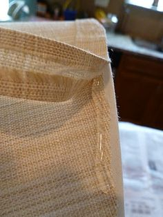 Make your own trim when recovering lamp shades by using stitch witchery.  Why didn't I see this two months ago!?!