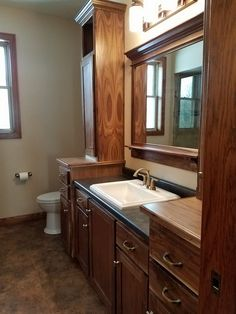 black walnut bathroom vanity and cabinets