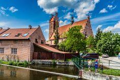 The view from the Lyna river on the Basilica of the Most Holy Saviour and All Saints (Bazylika Najswietszego Zbawiciela i Wszystkich Swietych) in Dobre Miasto (Guttstadt or Guddestat), Warmia region, Poland