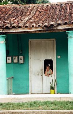 Doorway in Cuba A lady in rural Cuba watching by EndlessDrawings, $35.00