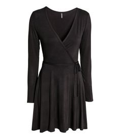 Dark red. Long-sleeved V-neck dress in soft viscose jersey. Wrapover front with decorative tie at side.