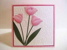 Memory Box card created by a design team member and featured on the MB blog. Rhapsody stencil with embossing paste for the background and Tulip stems is the focal point.