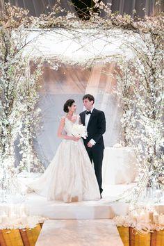 Ethereal White Floral Chuppah at Gotham Hall in Manhattan. Photos by Jasmine Hsu. Wedding flowers by Bride & .