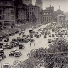 #Montreal's Champs de Mars area has had quite the transformation over the last century. It was once a military parade ground surrounded by Montreal's fortifications and was then paved over — as seen in this photo from July 3, 1930 — to become a parking lot. The city eventually decided to turn the grounds into a park in the 1980s. The fort walls were found during the transformation and are now highlighted in the landscape. This photo was found in the @montrealgazette #archive library.