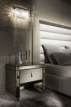 Use as a bedside table, modern side table or as a welcome in any hallway. Adding contemporary style and sophistication to any setting. The Modern Mirrored Alligator Embossed Effect Leather Bedside Table with drawer at Juliette's Interiors is the most stunning piece of contemporary design. Truly versatile!
