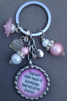 This listing is for one TEACHER APPRECIATION bottle cap key chain.    This key chain is adorable. It has a little school house charm, an apple charm and is decorated with pink and pearl beads.    Several sayings to choose from. If you wish to have a different image than the one shown, just let me...